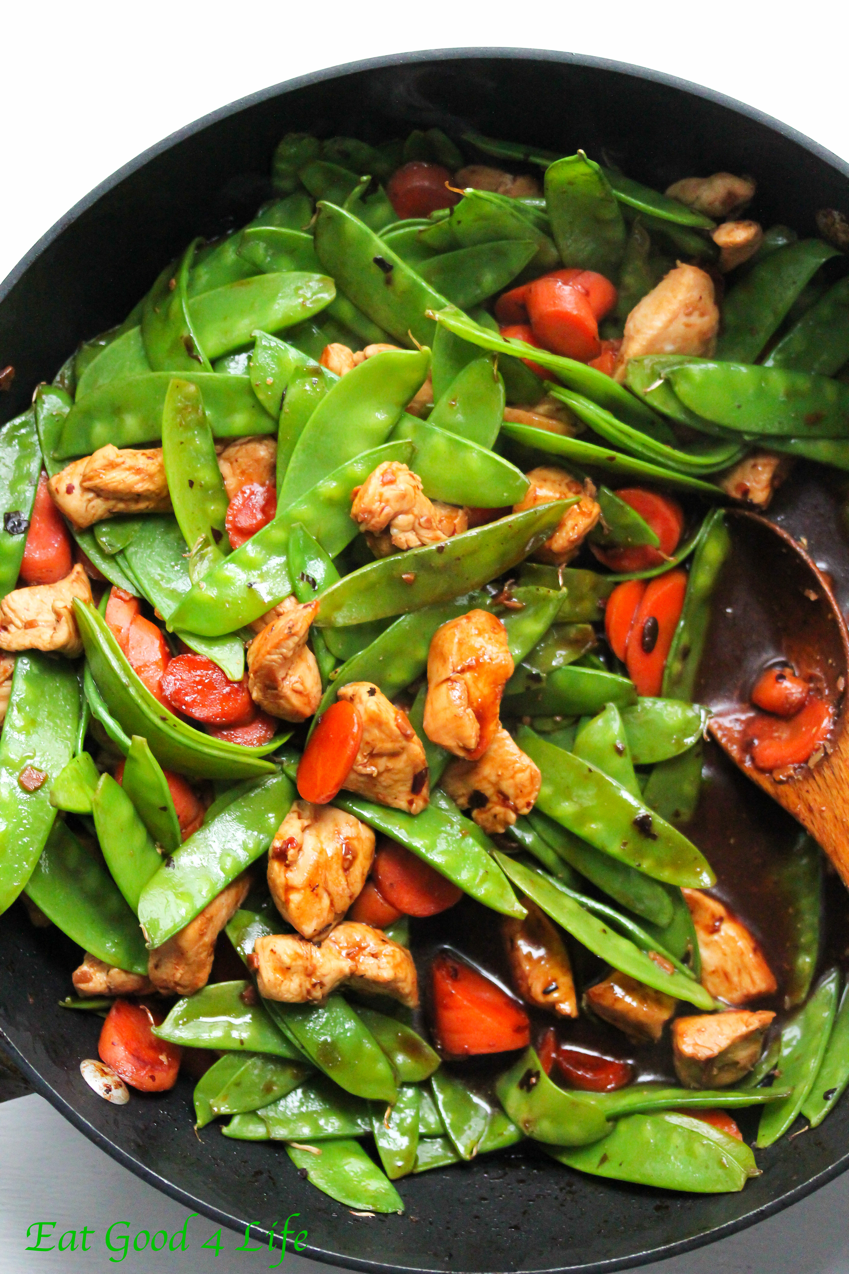 Black bean chicken stir-fry with snow peas and carrots