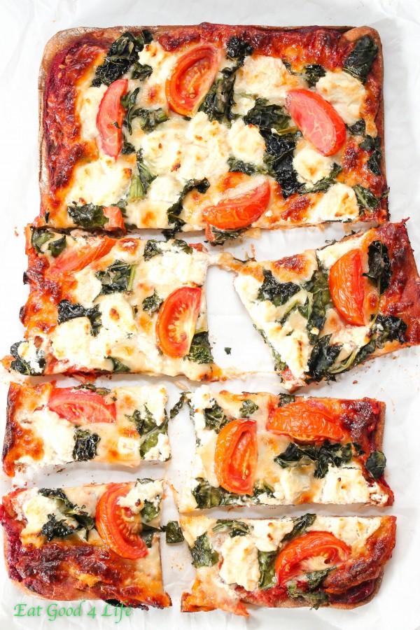 Kale, tomato, goat cheese pizza